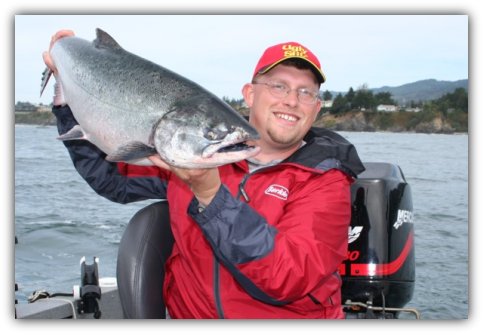 Oregon salmon fishing trips - Capt. Andy Martin with a Chetco Bay salmon caught on plug-cut herring