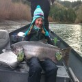 Ella with her first salmon, a chromer Chetco king from December 2011.
